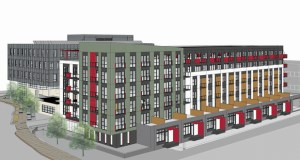 L&H Station Development wants to construct a 100,000-square-foot office building for Hennepin County (right) and 125-unit apartment building (background) next to a Minneapolis Public Schools building at 2225 E. Lake St. Construction on the first phase could begin next year. (Submitted rendering: BKV Group)