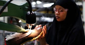 Muslima Hassan trims the rubber bottom of an L.L. Bean boot Dec. 2 at a facility in Lewiston, Maine. Payroll processor ADP reported Wednesday that companies added 241,000 workers in December. (AP File Photo)