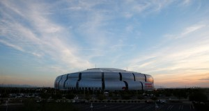"University of Phoenix Stadium, site of NFL Super Bowl XLIX football game, is seen here at sunset Dec. 11 in Glendale, Arizona. The entire world will be watching Glendale on Sunday as it hosts the Super Bowl, but Glendale's mayor says the city will actually lose a ""couple million dollars"" by hosting the event. (AP Photo: Ross D. Franklin)"