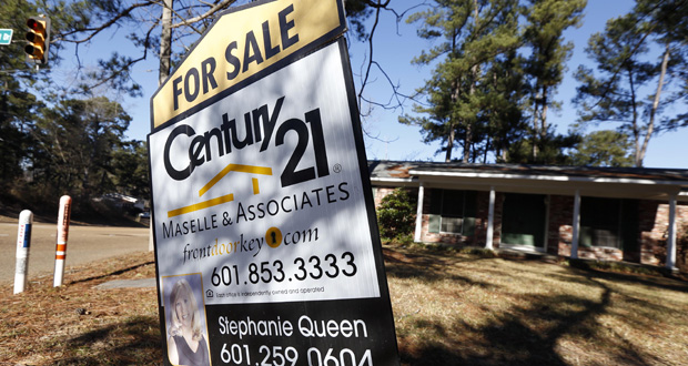 A realty sign is posted in front of a home for sale Jan. 8 in Jackson, Mississippi. Standard & Poor's reported Tuesday that the S&P/Case-Shiller index of home prices increased 4.3 percent in November. (AP Photo: Rogelio V. Solis)