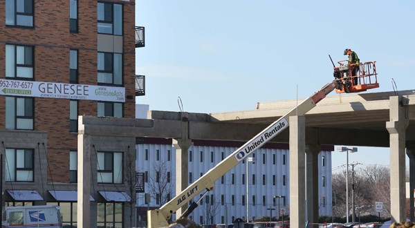 The use of tax-increment financing has helped push forward projects in the Penn-American District in Bloomington, currently home to the 234-unit apartment building (background) and an under-construction hotel and retail development. (Staff photo: Bill Klotz)