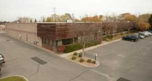 After more than three decades, the original owners of this office warehouse at 6035-6037 Baker Road have sold it for $2.1 million. (Submitted photo: CoStar)