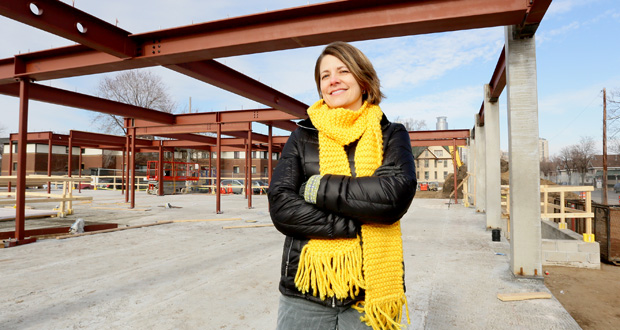"Gina Ciganik, Aeon's vice president of housing development, stands on the construction site of The Rose, an affordable apartment development at 1920 Portland Ave. S. in Minneapolis. ""It is poor people in poor communities who are most in need of healthy great places to live because they have such limited options,"" Ciganik said. (Staff photo: Bill Klotz)"