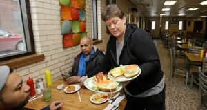 Jamie Blevins delivers food to customers Jan. 23 at the Superior Restaurant, in Cleveland. The Institute for Supply Management reported that services firms grew at a faster pace in January. (AP Photo: Tony Dejak)