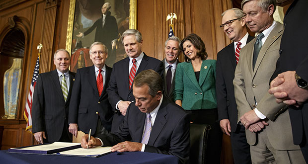 House Speaker John Boehner signs the bill Feb. 13 authorizing expansion of the Keystone XL pipeline. In contrast, President Barack Obama vetoed the bill in private with no fanfare. (AP photo)