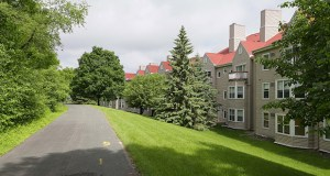 The current Southwest Light Rail Transit route alignment would travel through the wooded area near a trail on the southwest side of the 330-unit Claremont Apartments complex in Minnetonka.  (File photo: Bill Klotz)