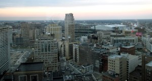 This photo shows downtown Detroit at dusk Dec. 4, 2014, as seen from an upper floor of the Westin Book Cadillac, the city's fanciest hotel, which has condo apartments on the top floors. The 4,470-square-foot penthouse suite on the 29th floor will be priced close to $2 million when it comes on the market, and real estate broker Jerome Huez says it will be the city's most expensive apartment. Elsewhere around the city, thousands of houses have been abandoned and many will be foreclosed upon this spring, then eventually auctioned off for $500 apiece. (AP Photo: Beth J. Harpaz)