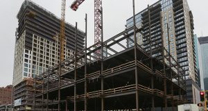 Construction activity on the 400 block of Marquette Avenue in downtown Minneapolis includes the 4Marq apartment tower, left, the new Xcel Energy headquarters, center, and the completed Nic on Fifth apartment building. Mortenson Construction officials said this week that 4Marq will be topped out by the second week of May. (Staff photo: Bill Klotz)