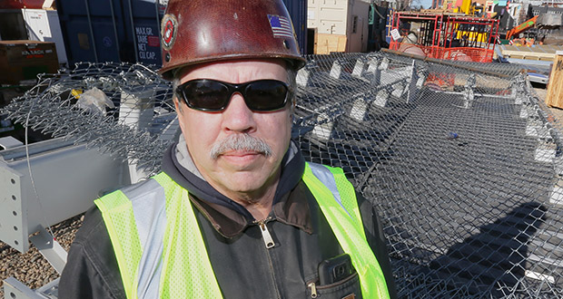 """Dave Bice, president of Bald Eagle Erectors, stands by a """"snow catch"""" his company is building for the Minnesota Vikings stadium project. (Staff photo: Bill Klotz)"""