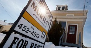 A sign indicates a house for rent Feb. 25 in Zelienople, Pa. Home rental prices nationally climbed a seasonally-adjusted 3.7 percent in March from 12 months earlier, real estate data firm Zillow said Wednesday. (AP Photo: Keith Srakocic)