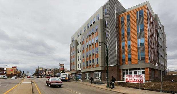 Wellington Management's Lake Street Station senior apartment project at the corner of Lake Street and Hiawatha Avenue on the Blue Line in Minneapolis has only a few surface parking spaces because many residents don't have cars. (Staff photo: Bill Klotz)