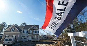 A flag advertising a newly built home for sale flaps in the breeze in Richmond, Va. The Commerce Department reported Thursday that sales of new U.S. homes plummeted in March. (AP File Photo)