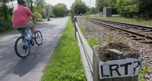 The proposed route of the Southwest Light Rail Transit route includes the Kenilworth Corridor, a narrow and environmentally sensitive area between Cedar Lake and Lake of the Isles. (File photo: Bill Klotz)