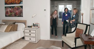 This April 26 photo provided by courtesy of the Larchmont Historical Society shows visitors looking at a bedroom on the Seabreeze House tour sponsored by the Larchmont Historical Society in Larchmont, N.Y. (Rosemary Mancino: Larchmont Historical Society via AP)