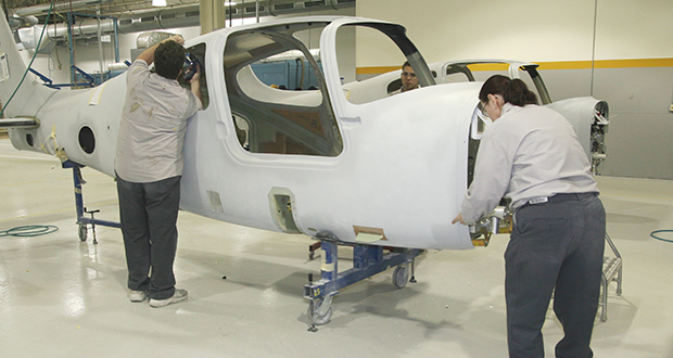 Legislators approved a $4 million in state aid for a Cirrus Aircraft expansion that virtually guarantees the company will stay in Duluth. In this photo, workers assemble a plane at the company's Duluth plant. (Submitted photo: Cirrus Aircraft)