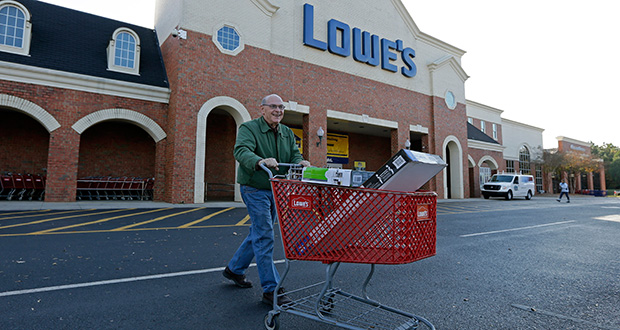 A customer leaves a Lowe's home improvement store Nov. 18, 2014, in Charlotte, N.C. Lowe's Cos. Inc. reported Wednesday that sales and profit were up in the first quarter but short of Wall Street expectations. (AP file photo)