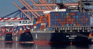 Container ships wait to be unloaded at the Port of Los Angeles. The Commerce Department reported Tuesday that the U.S. trade deficit grew to its highest level in more than six years in March. (AP file photo)