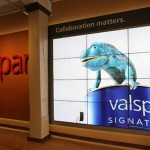 The Valspar building's lobby features displays describing the company's history and business and a wall-sized photo montage.