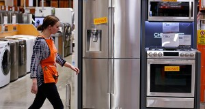 An employee walks past a display of appliances March 23 at a Home Depot in Robinson Township, Pennsylvania. The Commerce Department reported Tuesday that durable goods orders dropped 1.8 percent in May. (AP Photo: Gene J. Puskar)