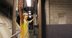 Michael Reedy, a senior at the University of Minnesota majoring in graphic design, gave a tour of the space where the organ pipes would be located at the Northrop auditorium in Minneapolis. The area is directly above the stage and is reached by a catwalk. (Staff photo: Bill Klotz)