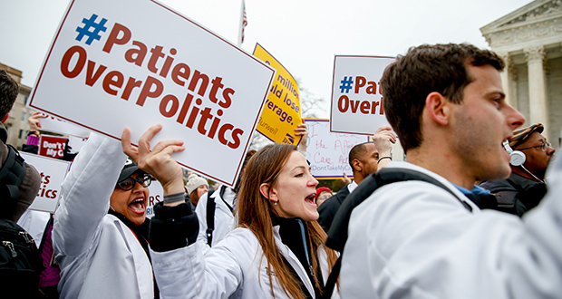 Demonstrators chant during health care rally March 4 outside the Supreme Court in Washington. (AP file photo: Andrew Harnik)