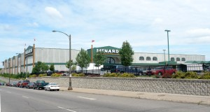 Home improvement giant Menard Inc. has acquired an industrial property at 635 Prior Ave. N. in St. Paul (below), expanding the company's control of land around its Midway store at 2005 University Ave. (above). (Submitted photos: CoStar)