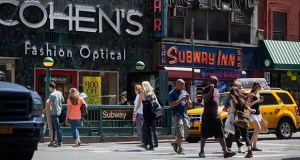 Pedestrians pass the Subway Inn bar July 25, 2014, in New York. Kuafu Properties LLC, a New York-based Chinese investment firm formed two years ago, plans to build a condominium tower at the former bar's Upper East Side site. (Bloomberg file photo)