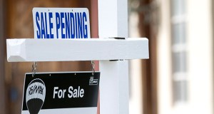 "A ""sale pending"" sits atop a realty sign Jan. 8 outside a home for sale in Surfside, Florida. The National Association of Realtors reported Wednesday that its pending home sales index declined 1.8 percent in June. (AP file photo)"