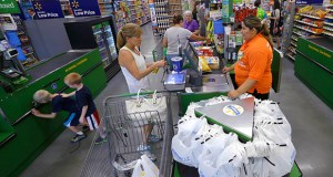 A customer checks out at a Wal-Mart Neighborhood Market store June 4 in Bentonville, Arkansas. The Commerce Department reported Tuesday that retail sales fell 0.3 percent in June. (AP Photo: Danny Johnston)