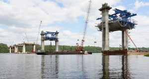 Concrete piers and segments for the $626 million St. Croix Crossing rise above the river between Oak Park Heights and St. Joseph, Wisconsin. Work is moving along, but the project is unlikely to hit the 15.7 percent goal for Disadvantaged Business Enterprise participation. (Staff photo: Bill Klotz)