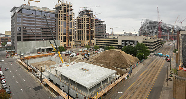 The Downtown East Commons park in Minneapolis will rise on the site of the former Star Tribune building and parking area, where demolition began this week. The park site is in the middle of Downtown East construction activity, with two new office towers going up for Wells Fargo, the Edition apartments underway and the new Vikings stadium. (Staff photo: Bill Klotz)