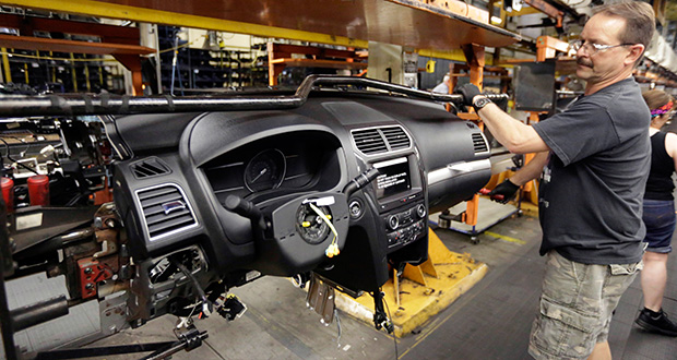 A Ford Motor Co. employee works on the instrument panel of a 2016 Ford Explorer June 19 at the Chicago Assembly Plant in Chicago. The Commerce Department reported Wednesday that orders for durable goods rose 2 percent in July. (AP file photo)