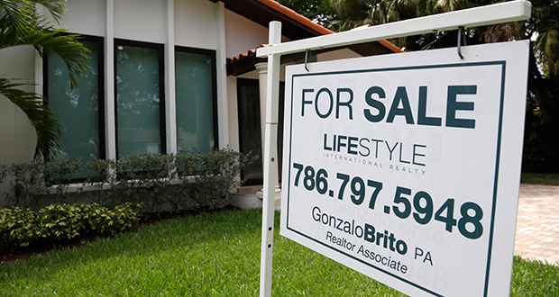 A for sale sign sits in front of a home Aug. 15 in Miami. The Standard & Poor's/Case-Shiller 20-city home price index rose 5 percent from a year earlier. (AP Photo: Lynne Sladky)
