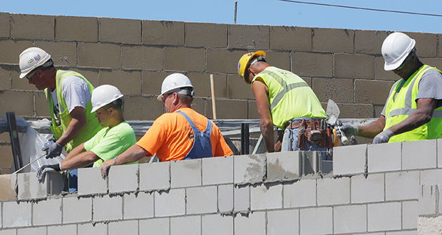 Masons on Thursday lay concrete block as part of an unspecified retail project on the 5300 block of Central Avenue Northeast in Fridley. Construction projects continue to churn in Minnesota, but are leveling out after a post-recession blitz. (Staff photo: Bill Klotz)