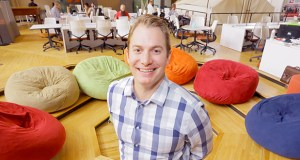 Justin Kaster, who ran the Cleantech Open Midwest office since its inception, is turning over its management to the University of St. Thomas' Schulze School of Entrepreneurship. Kaster is shown at the CoCo office in the former Midwest Grain Exchange building in Minneapolis. (Staff photo: Bill Klotz)