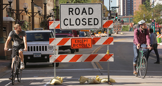 Road closed signs are pictured at 10th Street and Nicollet Avenue in downtown Minneapolis where utility work for the reconstruction project has already begun. (Staff photo: Bill Klotz)