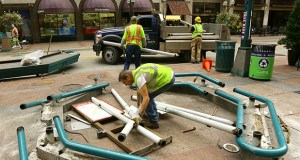 Workers disassemble a bus stop shelter Friday along Nicollet Mall. The downtown Minneapolis corridor is undergoing a $50 million facelift set to wrap up in 2017. (Staff photo: Bill Klotz)
