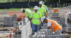 Construction workers handle concrete in late August at the site of Bloomington Central Station Apartments, a 415-unit complex rising on the south side of American Boulevard in Bloomington, between 33rd and 34th Avenues South. (Staff photo: Bill Klotz)