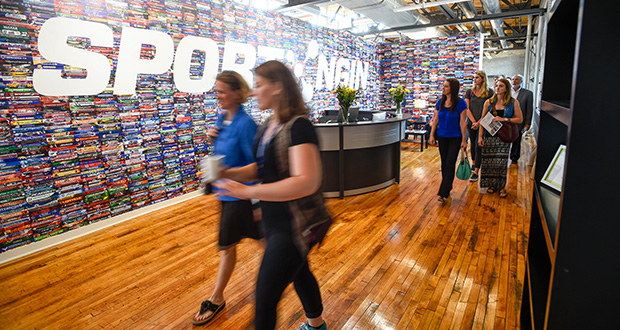 Guests walk through the new offices of Sports Ngin during a tour Tuesday of the Highlight Center, which involved extensive renovation of the former Minneapolis Public Schools headquarters at 807 Broadway St. NE. (Photo: Craig Lassig)