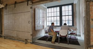 The North Loop is full of revamped industrial spaces with high ceilings, with interiors peeled back to their original brick and concrete. This meeting room at LHB's 701 Washington Ave. N. office is a converted freight elevator. (Staff photo: Bill Klotz)