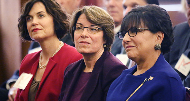 U.S. Secretary of Commerce Penny Pritzker, right, listens to a speaker while sitting next to Sen. Amy Klobuchar, D-Minn., center, and Minneapolis Mayor Betsy Hodges. (Staff photo: Bill Klotz)