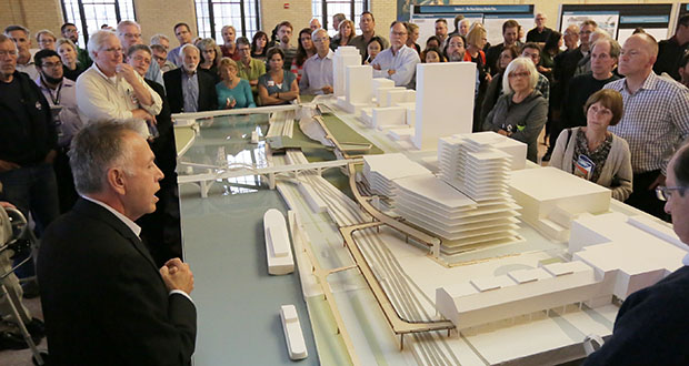 Mic Johnson, a fellow at the University of Minnesota's Metropolitan Design Center, explains a model of St. Paul's proposed River Balcony project to community members at an unveiling Thursday night at Union Depot. (Staff Photo: Bill Klotz)