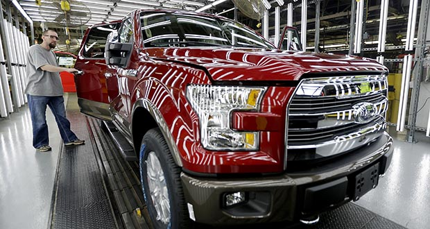 A worker inspects a new 2015 aluminum-alloy body Ford F-150 truck March 13 at the company's Kansas City Assembly Plant in Claycomo, Missouri. The Commerce Department reported Thursday that orders for durable goods fell 2 percent in August. (AP file photo)