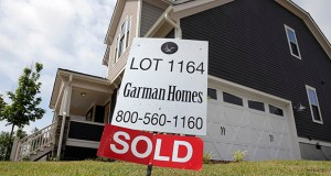 A sold sign is displayed in the yard of a newly built home in the Briar Chapel community in Chapel Hill, North Carolina. The Commerce Department reported Thursday that new-home sales jumped 5.7 percent in August. (AP file photo)