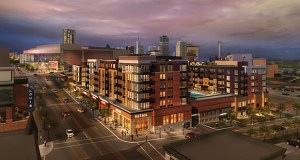 Private equity titan Carlyle Group bought into Opus Group's 191-unit apartment project at the former Seven Corners Hardware site, southwest of the Xcel Energy Center. (Submitted rendering)