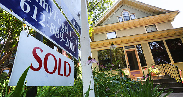 """This house on Irving Avenue South in Minneapolis displayed a """"Sold"""" sign in August. In contrast to the country as a whole, the Twin Cities metro area saw another solid increase in home sales in August. (File photo: Bill Klotz)"""