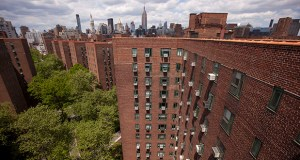 The New York City skyline stands beyond Stuyvesant Town-Peter Cooper Village, Manhattan's largest apartment complex. The complex was built in the 1940s by MetLife Inc., with city assistance, to house World War II veterans. File photo: Bloomberg News