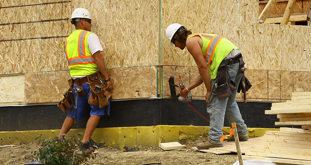 Workers build a home Aug. 27 at the Meadow at Cedar Landing development by Ryland Homes on Goodhue Way in Lakeville. Homebuilders are feeling better about the housing market this month, according to the National Association of Home Builders/Wells Fargo builder sentiment index released Monday.