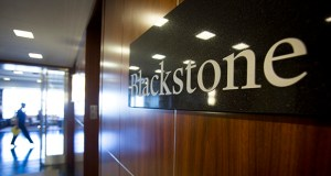 The Blackstone Group LP logo hangs in the company's offices in New York on June 4, 2013. Blackstone has agreed to buy life-science building owner BioMed Realty Trust for $4.8 billion. (Bloomberg file photo)