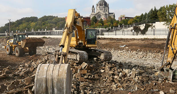 An excavator crushes concrete rubble at 411 Main St. in St. Paul, site of the future Higher Ground St. Paul building. Higher Ground is the first phase of the $100 million emergency housing, permanent housing and support services project for the Dorothy Day Center. (Staff photo: Bill Klotz)